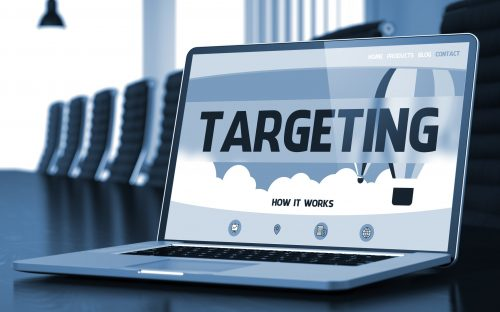 Targeting on Landing Page of Laptop Screen. Closeup View. Modern Meeting Hall Background. Blurred. Toned Image. 3D.